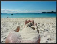 a handful of Whitehaven Beach silica
